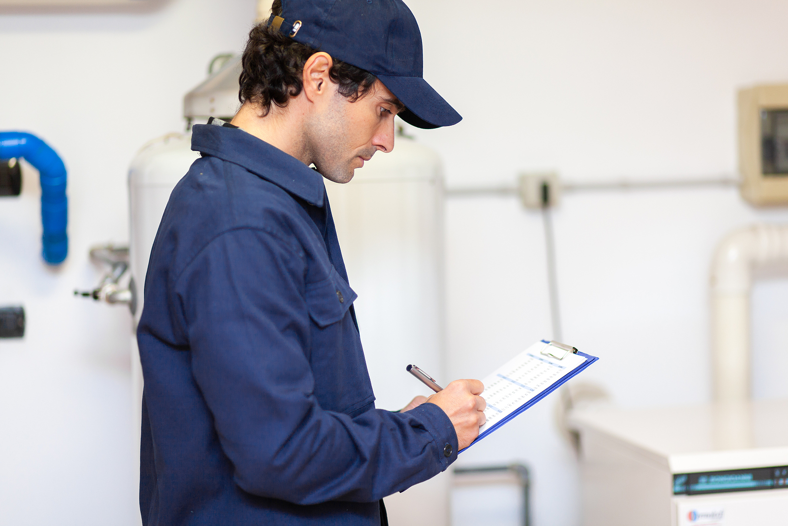 Technician servicing a gas hot water system installation