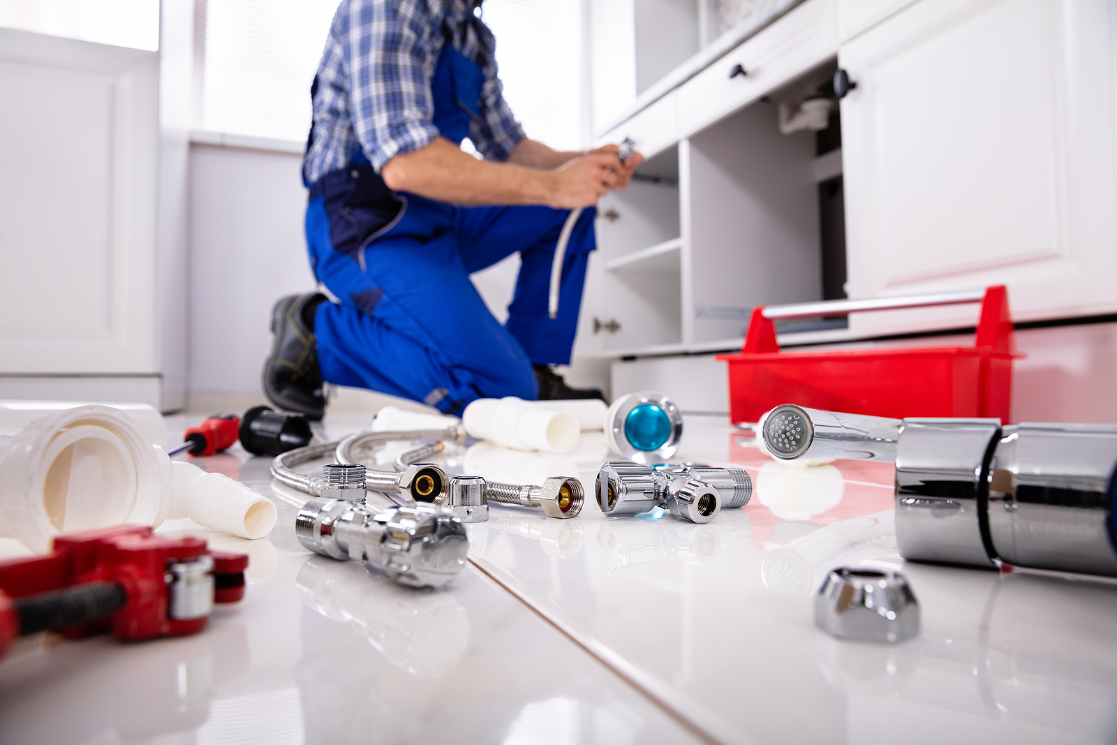 Plumber in Lower Hutt and his tools on the floor